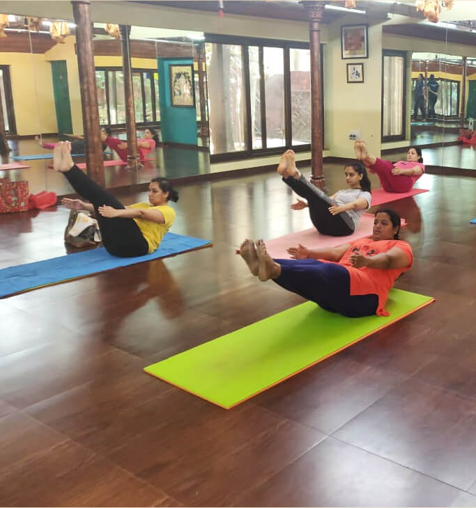 Naukasana Boat Yoga Pose demonstrated by ladies at our yoga classes in malleshwaram, bangalore
