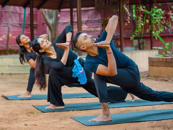Parivrtta Parsvakonasana done by Mimi, Shyam and Chinmayi during yoga classes at our centre at Malleshwaram