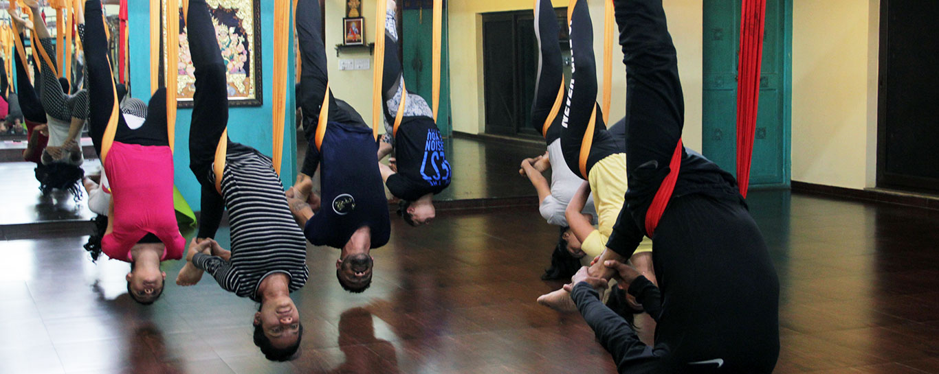 Vampire pose as a part of Aerial Yoga Classes at Srikrishnawellness and yoga centre in Malleshwaram
